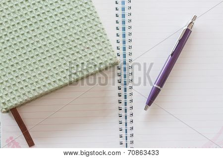 Top View Of Green Notebook, Pen And Spiral Notebook