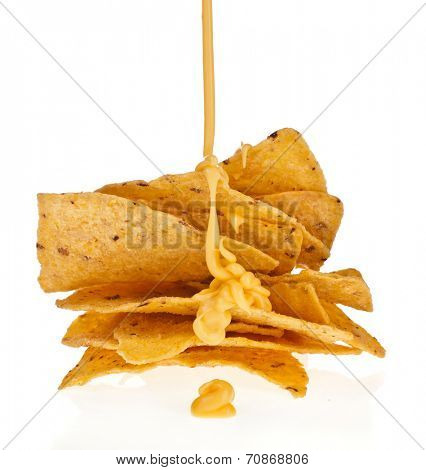 Salted corn chip nacho snack with cheese sauce isolated on white background