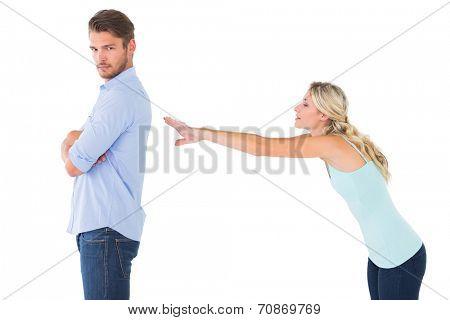 Desperate blonde reaching for boyfriend on white background