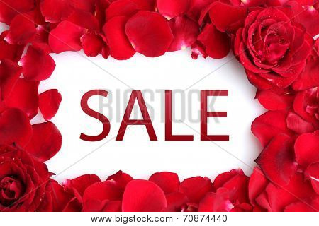Concept of discount. Beautiful petals of red roses
