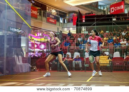 AUGUST 21, 2014 - KUALA LUMPUR, MALAYSIA: Madeline Perry of Ireland (pink) plays Nour El Tayeb of Egypt (red/white) in the CIMB Malaysian Open Squash Championship 2014 match held in Nu Sentral Mall.