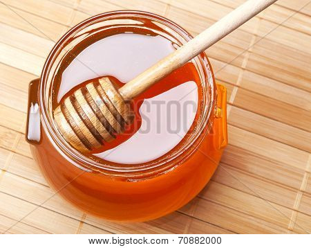 Glass Jar Of Honey With Wooden Drizzler