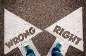 Wrong and right dilemma concept with man legs from above standing on signs poster