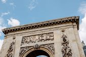 """Porte Saint-Denis triumphal arch with the entablature bronze inscription LUDOVICO MAGNO """"To Louis the Great"""". Built in 1672 and designed by architect François Blondel and the sculptor Michel Anguier at the order of Louis XIV poster"""