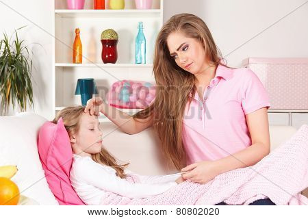 Mother With Ill Child At Home