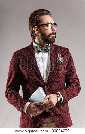Portrait Of A Handsome Stylish Young Man With Book In Hand