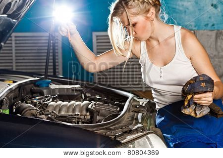 Girl Checks The Oil Level In The Car