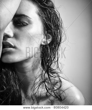 Portrait Of Attractive Brunette Girl Over Gray