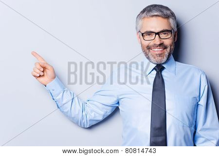 Businessman Pointing Copy Space.
