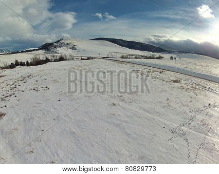 Aerial of Wind-sculptured Snowy Mountains
