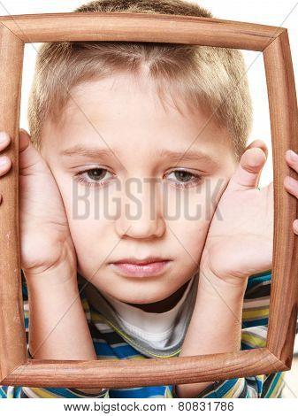 Little Sad Boy Child Framing His Face