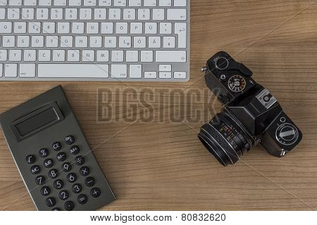Desktop With Camera Keyboard And Calculator