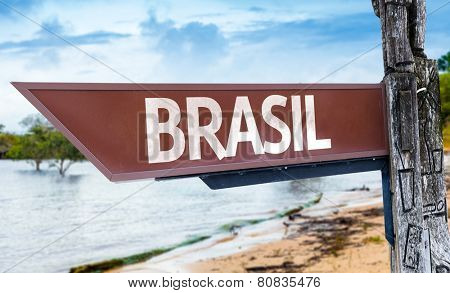 Brazil (in Portuguese) wooden sign with a lake background