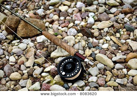 fly rod on stones