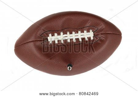 Closeup of an NFL American style football partially deflated with the valve stem still inserted. Isolated on white.