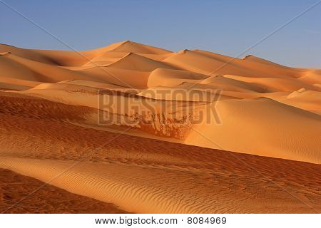 Abstract patterns in the dunes of the Rub al Khali or Empty Quarter. Straddling Oman Saudi Arabia the UAE and Yemen this is the largest sand desert in the world. poster