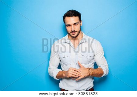 Handsome Adult And Masculine Man On A Blue Background