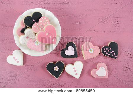 Pink, Black And White Homemade Heart Shape Cookies On Vintage Shabby Chic Pink Wood Background For V