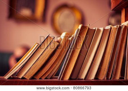 Old books in library shelf. Horizontal orientation. poster