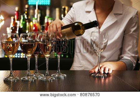 Bartender working at counter on bar background poster