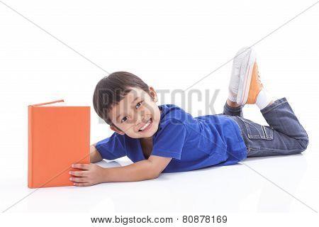 Little boy reading book