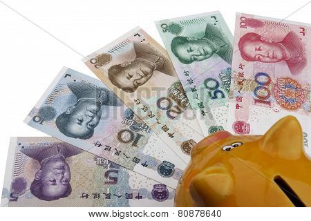 Piggy bank and Chinese money (RMB). 100 50 20 10 and 5 RMB note on a white background. poster