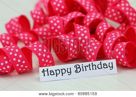 Happy birthday card with pink dotty ribbon