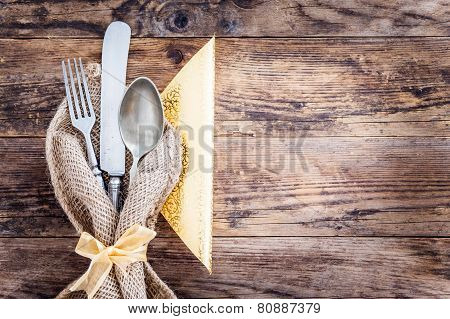 Old Knife, Spoon And Fork Decoratively Presented.