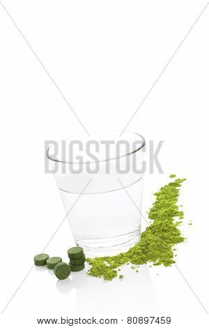 Green Food Supplements And A Glass Of Water.