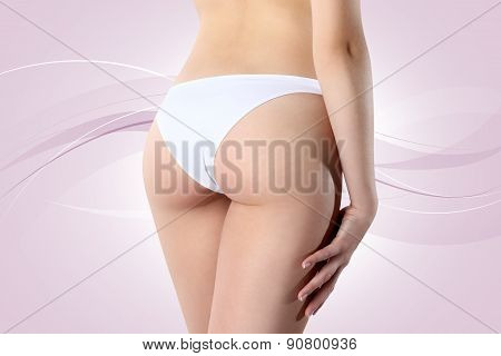 Bum And Legs Of Slim Woman Over Pink Background