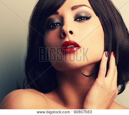 Bright makeup red lips woman with desire look and smokey eyes. Closeup vintage color portrait poster