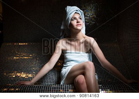 Spa woman.Beautiful girl after bath in jacuzzi spa,relaxing after massage,wrapped in towels.Skincare