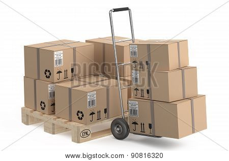 Cardboard Boxes On Pallet And Hand Truck