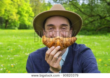 Man With Croissant