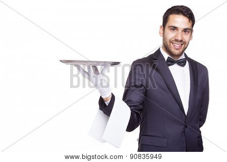 Smiling waiter holding an empty silver tray, isolated on white background