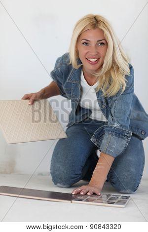 Young woman choose tiles