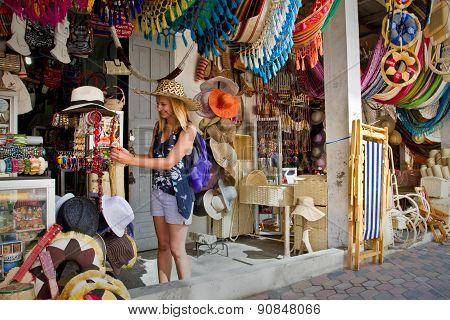 Unidentified happy female tourist in a handcraft market, Montecristi, Ecuador