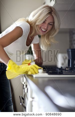Pretty housewife finished cleaning the kitchen