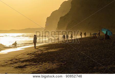 Women walking in the sunset