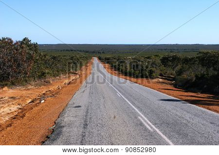 Sealed outback road to horizon
