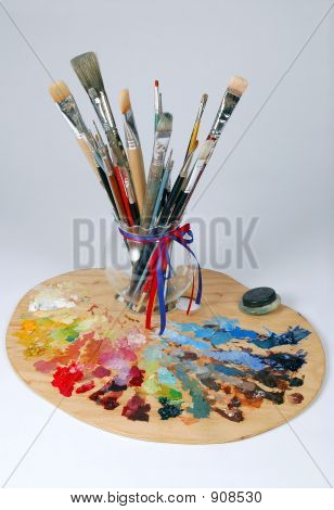 artist's palette and brushes over a white background. poster
