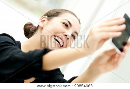 Vivacious Woman Taking Her Selfie
