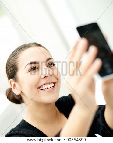 Happy Young Woman Posing For A Selfie