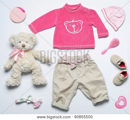 Top View Fashion Trendy Look Of Clothes And Cute Accessories For Baby Girl In Pink Color