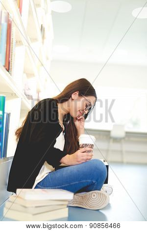 Pretty Young Female Student Sitting Studying