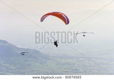 Paraglider and two pilot gliders