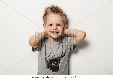 Portrait of cute little boy posing
