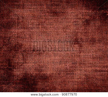 Grunge background of burnt umber burlap texture