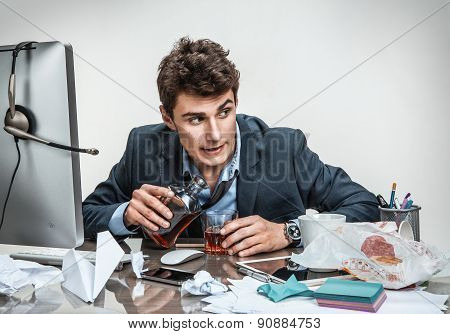Drunk Businessman Sitting Drunk At Office With Computer Holding Glass Looking Depressed Wearing Loos