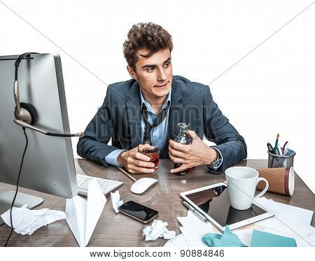 Young Alcoholic Business Man Drinking Whiskey Sitting Drunk At Office With Computer Holding Glass Lo